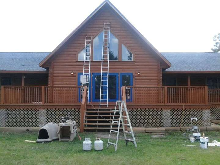 Exterior painting / staining of log cabin home in Eagle Lake FL.