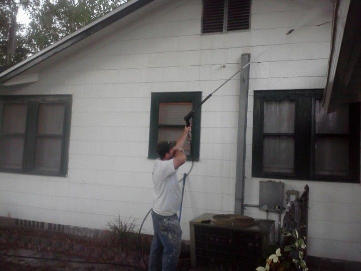 Pressure washing a house in Plant City FL.